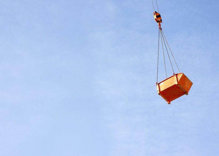 hazardous waste loaded into a facility by crane